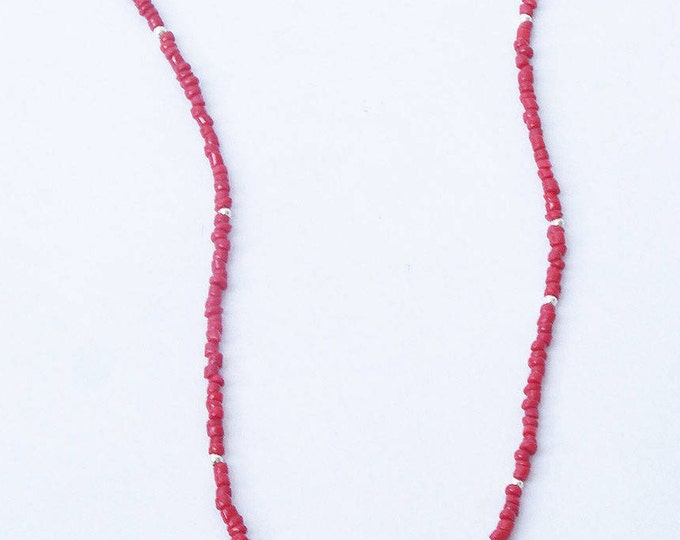 RAS neck composed of coral with an oval pendant beads