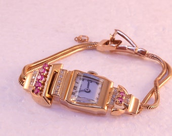 Ladies Watch, Swiss Made Lusina,14k Rose Gold, with rubies, diamonds, Circa 1950's
