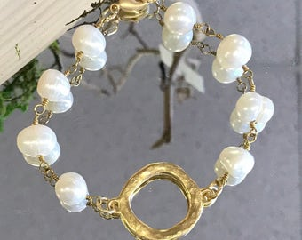 Gold ring and pearl bracelet