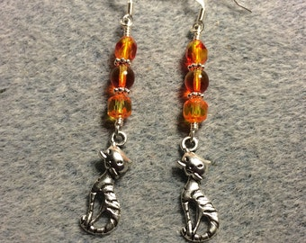 Silver tabby cat charm dangle earrings adorned with orange yellow Czech glass beads.