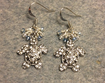 Silver with clear rhinestones turtle charm earrings adorned with tiny dangling light blue and clear Chinese crystal beads.