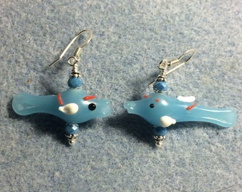 Opaque light blue and white lampwork fish bead earrings adorned with light blue Chinese crystal beads.