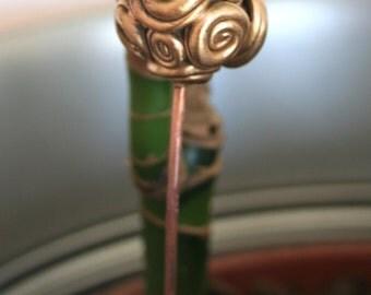 Sculpture to plant (bronze flower)