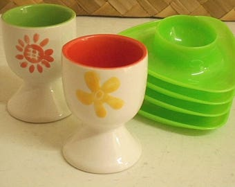 Retro Egg Cups ~  1970s Insect & Daisy Ceramic Pair plus Four Lime Plastic Stacking Cups