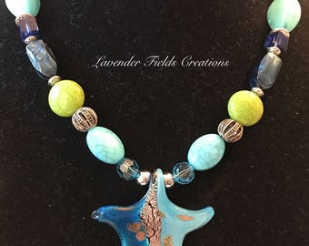 A Chunky, Blue and Green Beaded Statement Necklace with a Glass Starfish Pendant. (201712N)