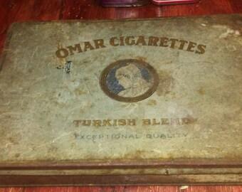 Antique, Omar Cigarettes tin.