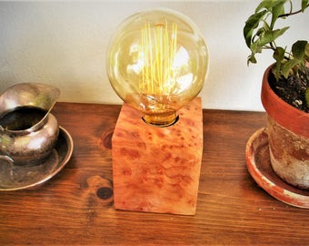 Spectacular redwood burl table lamp with an IN-LINE DIMMER switch and an Edison old world bulb.