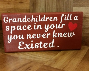 Grandchildren fill a space in your heart sign