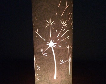 Blowing in the wind. Beautiful paper cut, candle shade