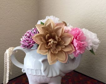 Adorable elephant vase with duct tape and fabric flower arrangment