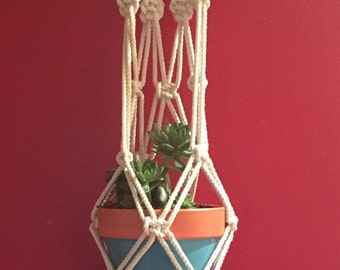 Boho macrame wall/plant hanger with painted wooden beads.