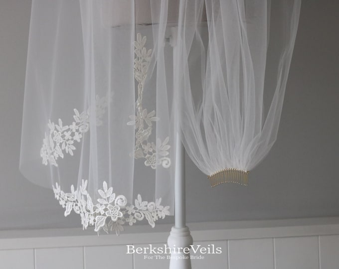 Chapel length wedding veil finished with appliqué lace