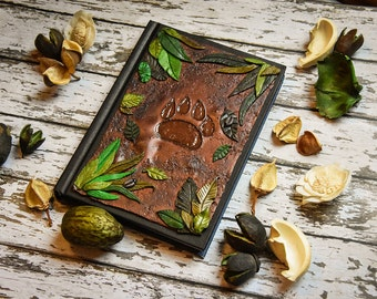 A6 polymer clay journal/ notebook cover. Paw, footprint in the nature, leaves, forest. Handmade art piece, sculpted polymer cover, book love