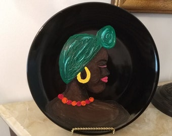 Hand painted ethnic ceramic plate by African American artist Karen Terry original design on black plate black art woman ethnic art