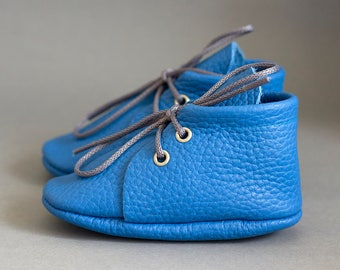 Blue baby moccasins with shoelaces