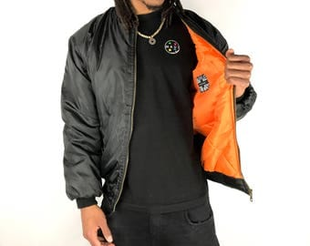 Ma1 Black Bomber Jacket. Size Small but Fits Like a Size Large. Black with orange Lining. Model Is 5'11 - 75kg