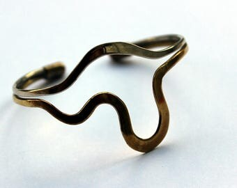 Gold and silver colored slave bracelet. Art deco style. In good state. bracelet. Slave.