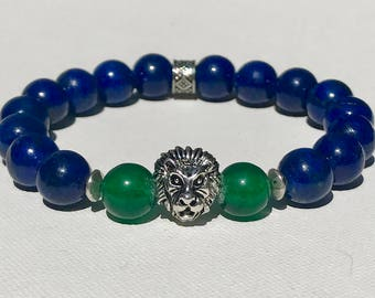 Lion Head in Silver on Lapis Stone 10mm w/ Green-Glass details