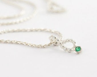Silver foxtail necklace with a pendant of bead wire and smaragd in white gold setting