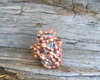 Swarovski crystals ring wrapped in copper seaweed. Makes a unique  gift or stocking stuffer.