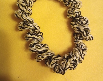 Bracelet crocheted with thread in yellow black and white
