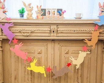 Garland rabbits of Easter decoration for home and room in felt