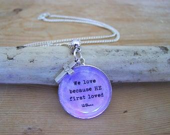 """Silver necklace with Christian Bible verse """"We love because he first loved us"""" (1 John 4:19) and cross charm"""