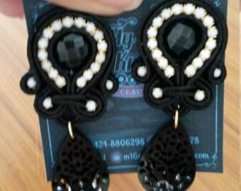 Black earrings with black acrylic
