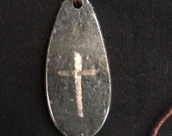 Teardrop pendent with cross engraved on it.
