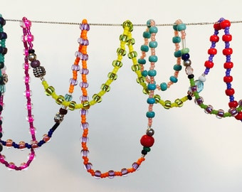 Long multicoloured seed bead necklace