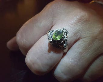 Poison Ring with light green Tourmaline stone set in Sterling Silver