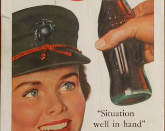 1953 Coca Cola ad.  1953 Coca Cola and Marine Corps ad.  Coca Cola and Marine Corps Service Woman.  Korean War.