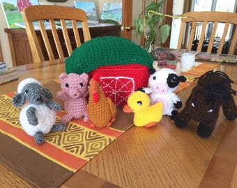 Crocheted farm animals and storage barn