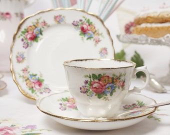 Dreamy vintage tea set by Colclough : tea cup, saucer and tea plate, so sweetly decorated with  flowers.