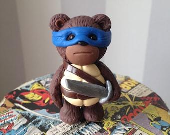 Turtle Comic Con Bear - Polymer clay bear figure dressed in style of Ninja Turtle Leo