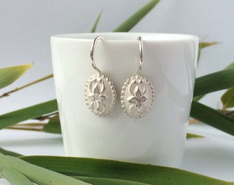 Silver, oval earrings with flower patterns and brilliant, height 10 mm