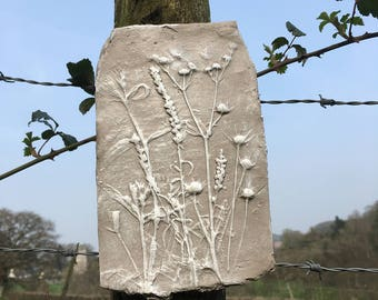 Rustic clay impression, mixed flower seed heads, natural clay and white colour. wall art.