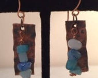 Hammered, copper earrings with blue accentj