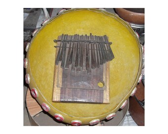 Fibre glass calabash gourd  amplification with a 23 key vintage thumb piano mbira kalimba