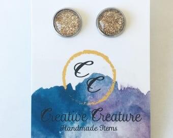 Gold glitter stud earrings