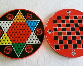 chinese checkers & checker metal round tin board game w/ knights crest and dragon designs - made in hong kong for ohio art - oriental asian