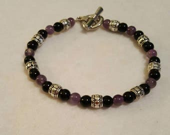 Womens bracelets with black and purple glass beads