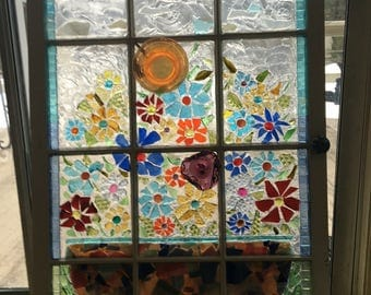 Old window decorated with various recyclable glass
