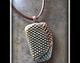 Elegant and modern handmade pendant in metallic tones