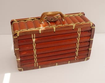 Retro suitcase in bamboo and rattan French 1970's. Nostalgic decoration, storage, picnic Vintage