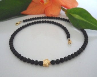 Fine lava necklace with Goldsternchen (4 mm)