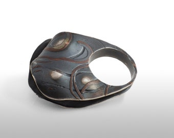 Ring in silver inlaid copper law