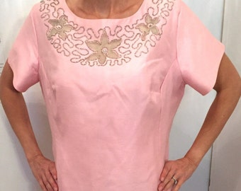 Cute 1950's pink dress with a subtle shine in the fabric, beaded flower neckline