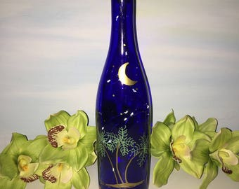 Recycled blue wine bottle lantern tropical