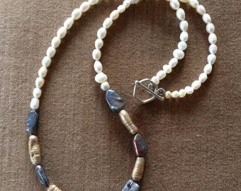 "23"" Freshwater pearls."
